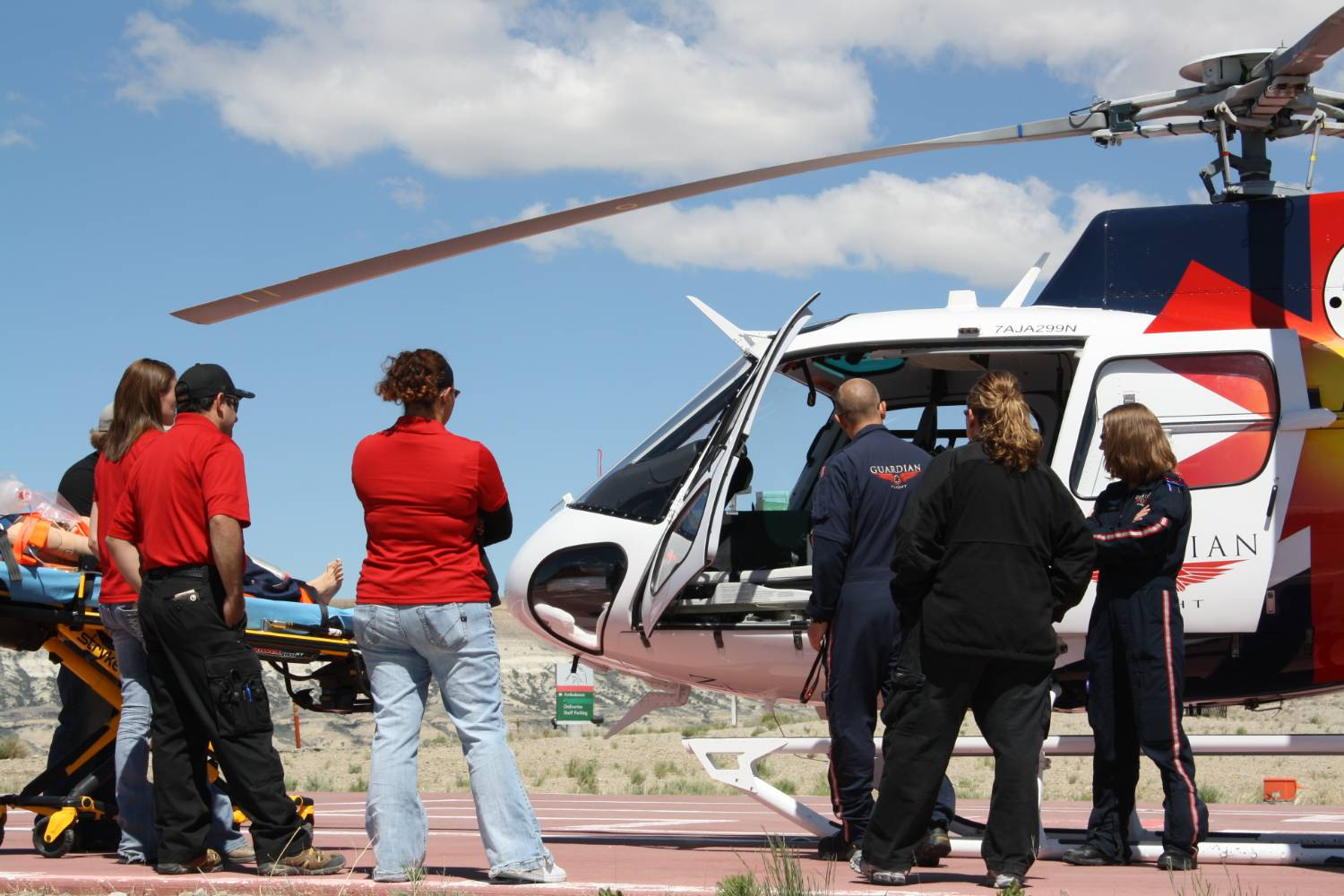 This is a picture of EMT students learning to load a patient into a helicopter